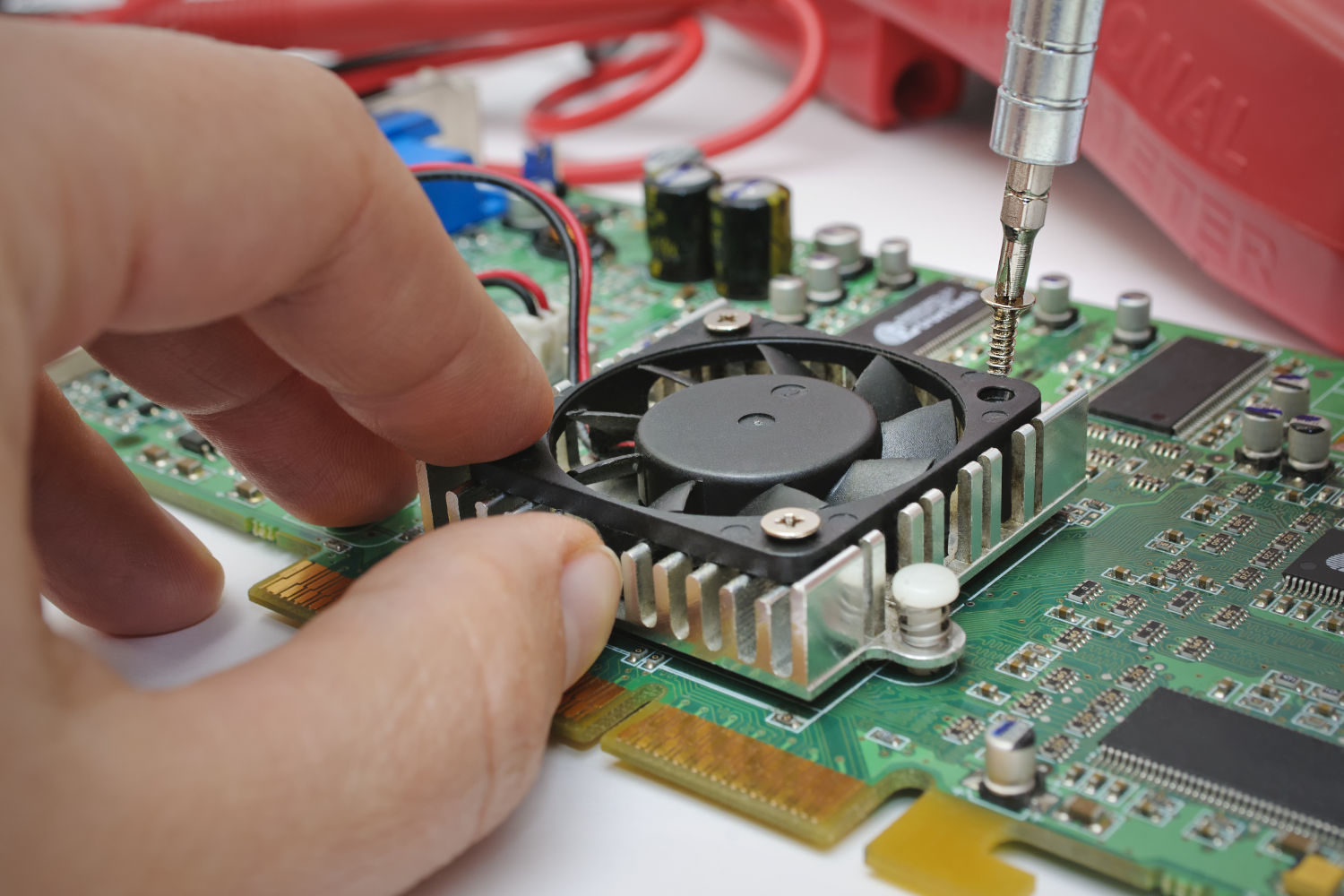 Electronic technician installs a cooler to a computer hardware